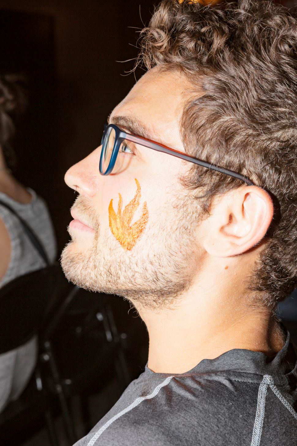 The author with a fire emoji face painting