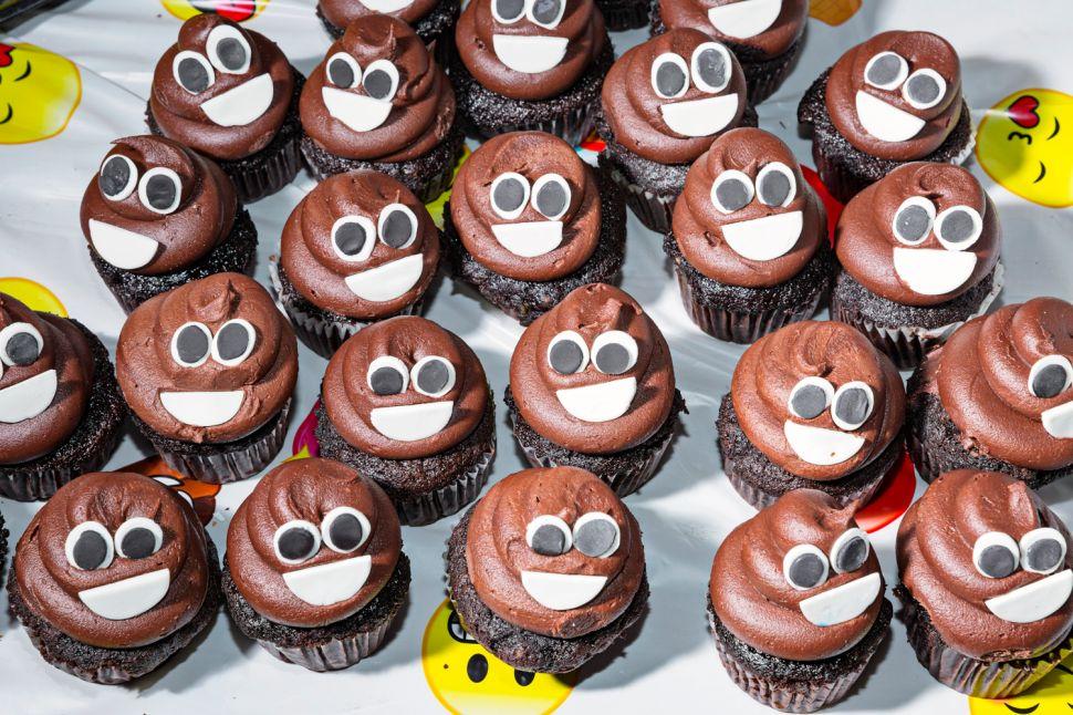 A display of poop emoji cupcakes