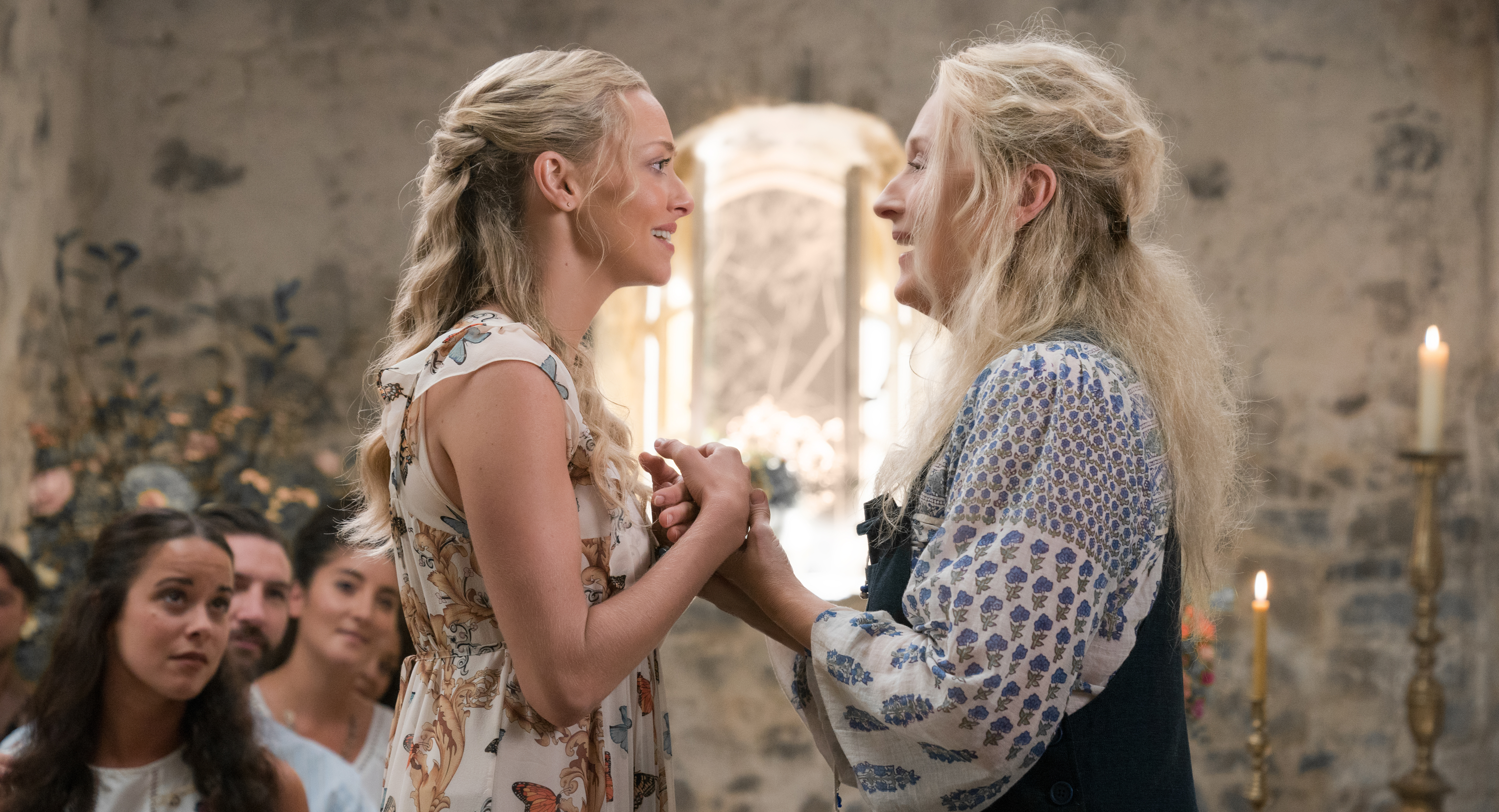 """(L to R) Sophie (AMANDA SEYFRIED) and Donna (MERYL STREEP) in """"Mamma Mia! Here We Go Again."""" Ten years after """"Mamma Mia! The Movie,"""" you are invited to return to the magical Greek island of Kalokairi in an all-new original musical based on the songs of ABBA."""