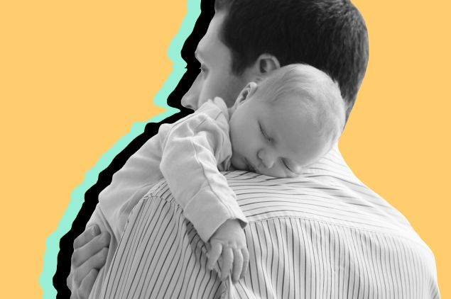 Father holds newborn on shoulder