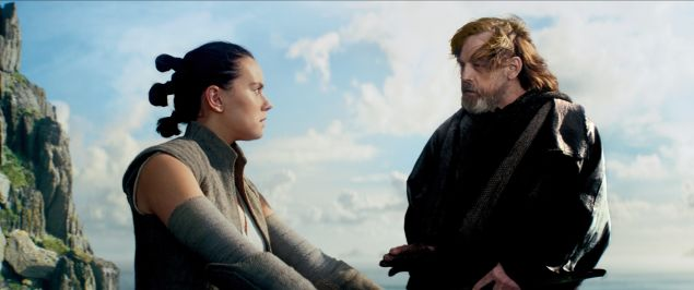 Daisy Ridley as Rey and Mark Hamill as Luke Skywalker in tar Wars: The Last Jedi.
