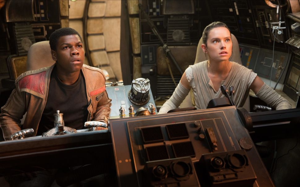 John Boyega as Finn and Daisy Ridley as Rey in Star Wars: The Last Jedi.