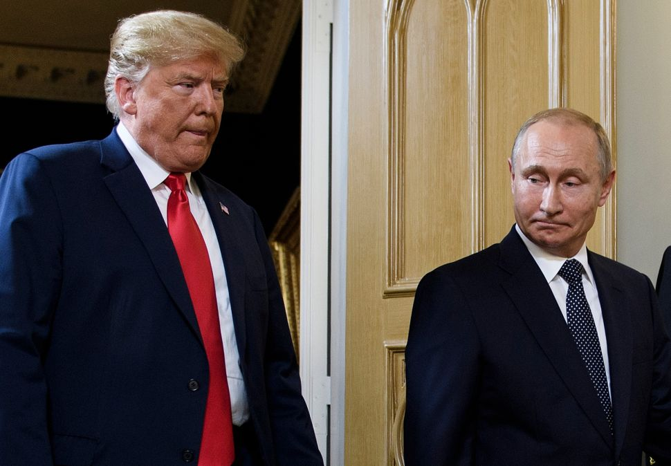 US President Donald Trump (L) and Russian President Vladimir Putin arrive for a meeting in Helsinki, on July 16, 2018. (Photo by Brendan Smialowski / AFP) (Photo credit should read BRENDAN SMIALOWSKI/AFP/Getty Images)