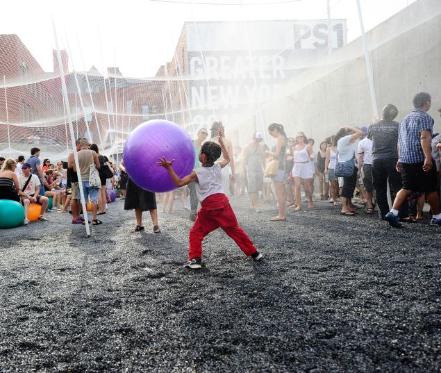 Children play under a fresh water sprinkler during a party at MoMA PS1.