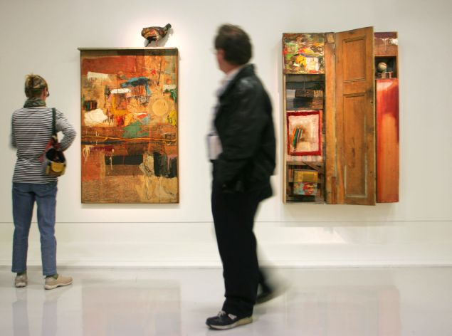 Visitors to the Centre Pompidou look at works Satellite and Interview by Robert Rauschenberg.