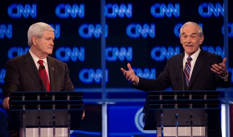 Former House Speaker Newt Gingrich (L) and Texas Rep. Ron Paul (R)