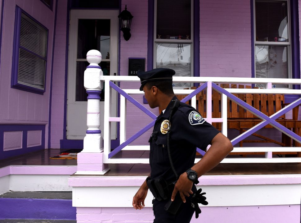 Camden County Police Department officer Vidal Rivera is seen on foot patrol in Camden, New Jersey