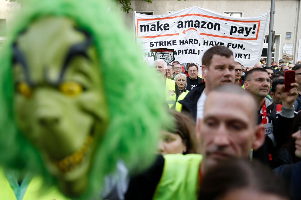 European Amazon employees, like these workers in Berlin, are protesting the company's working conditions during Prime Day. And for some reason, they brought the Grinch with them.