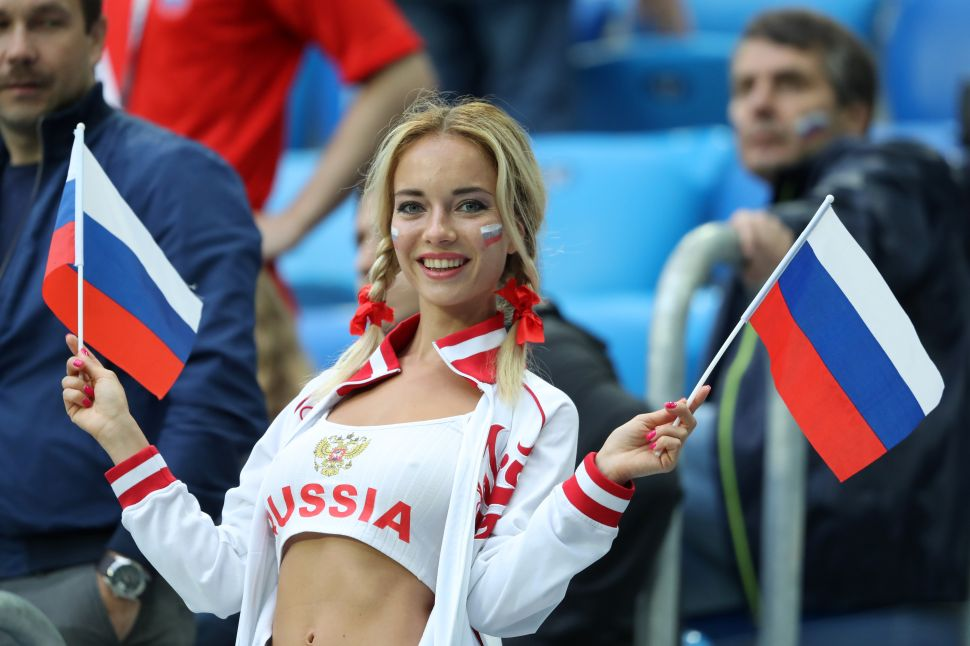 A Russia fan enjoys the pre match atmosphere prior to the 2018 FIFA World Cup Russia group A match between Russia and Egypt at Saint Petersburg Stadium on June 19, 2018 in Saint Petersburg, Russia.
