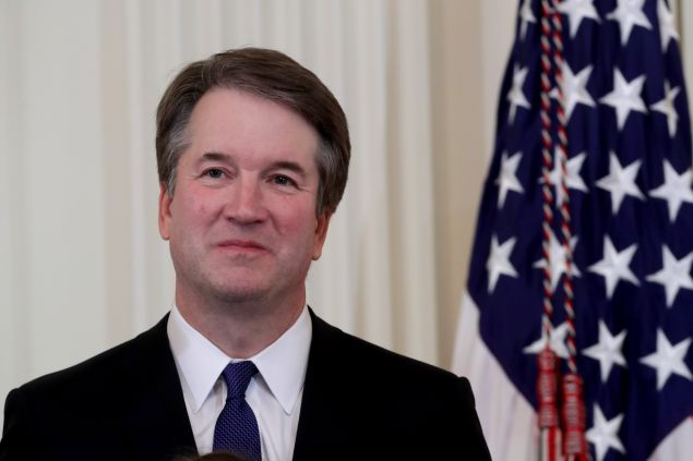 U.S. Circuit Judge Brett M. Kavanaugh looks on as U.S. President Donald Trump introduces him as his nominee to the United States Supreme Court during an event in the East Room of the White House July 9, 2018 in Washington, DC. Pending confirmation by the U.S. Senate, Judge Kavanaugh would succeed Associate Justice Anthony Kennedy, 81, who is retiring after 30 years of service on the high court.