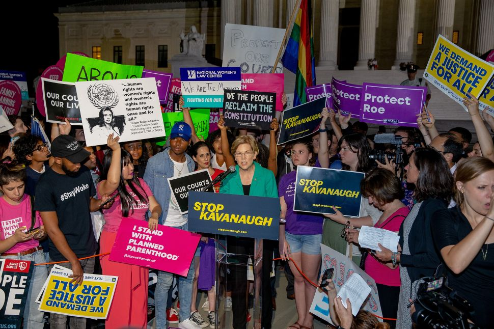 Senator Elizabeth Warren (D-Mass.) speaks to protesters in front of the U.S. Supreme Court.