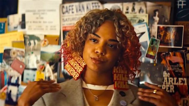 Tessa Thompson as Detroit wearing earrings that read 'murder' and 'kill' in Sorry to Bother You.