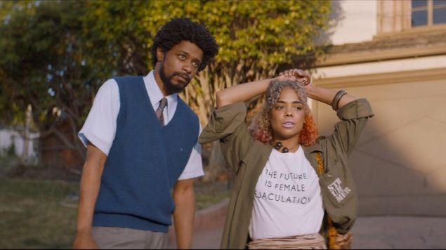 Tessa Thompson as Detroit wearing a shirt that reads 'The Future is Female Ejaculation.'