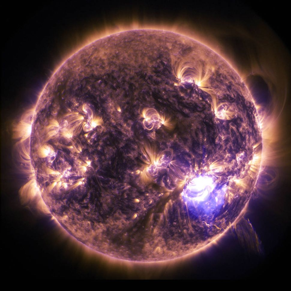 The sun emitted a significant solar flare, peaking at 7:28 p.m. EST on Dec. 19, 2014.