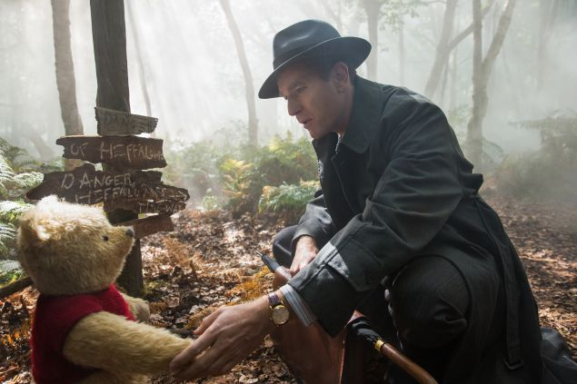 Ewan McGregor as Christopher Robin with Winnie the Pooh, voiced by Jim Cummings.
