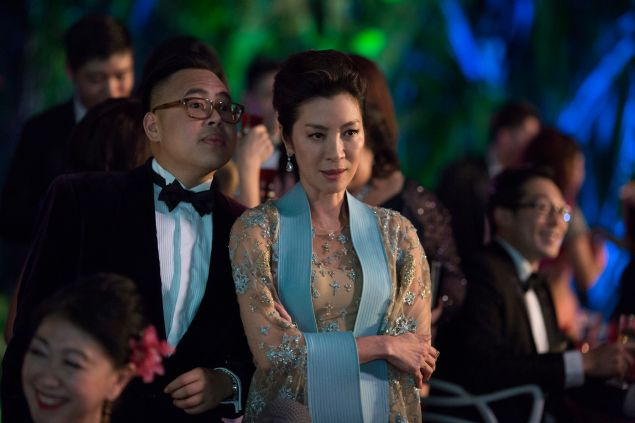 Nico Santos as Oliver and Michelle Yeoh as Eleanor in Crazy Rich Asians.