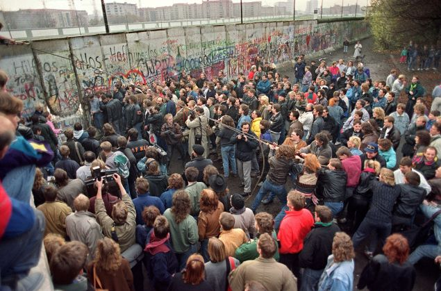 Berliners demolishing part of the Berlin Wall on 11 November, 1989.