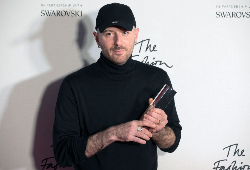 Designer Demna Gvasalia of fashion house Balenciaga poses with his award after being named winner of the International Ready-to-Wear Designer award during the British Fashion Awards 2016.
