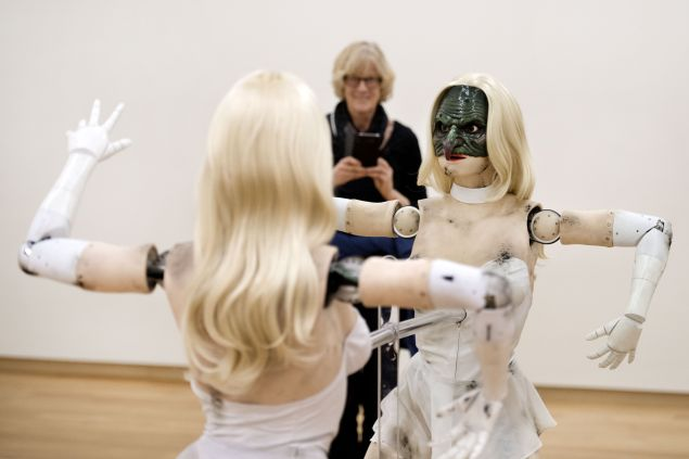 A woman looks at Female figure, an animatronic sculpture of a woman by US artist Jordan Wolfson, at the Stedelijk Museum in 2017.