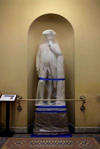 A statue of Benjamin Franklin wrapped in during a test of the U.S. Capitol's new smoke control system.