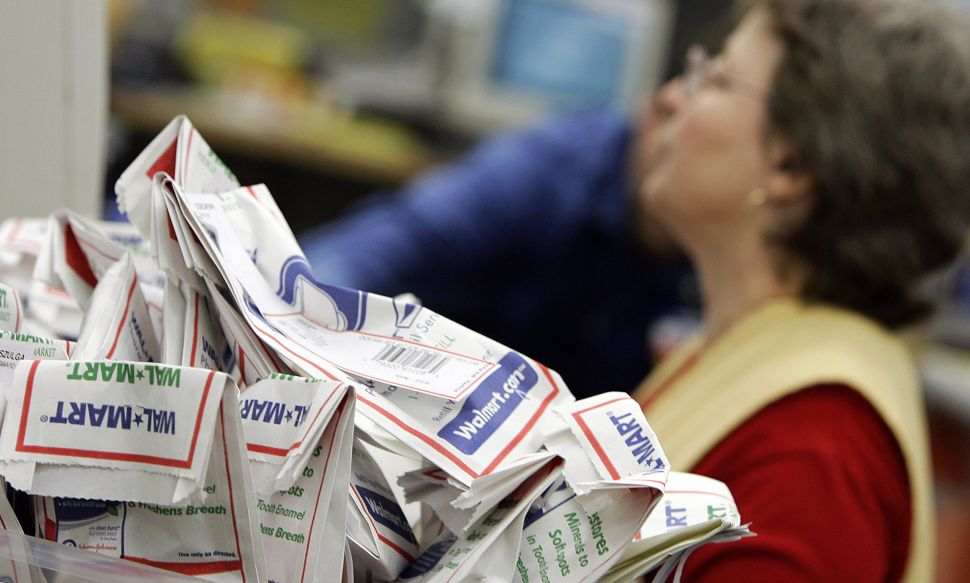 Filled prescription are stacked for sorting inside a Wal-Mart pharmacy.