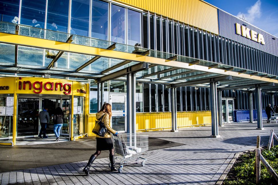 People walk outside a store of Swedish furniture giant Ikea in Delft, the Netherlands.
