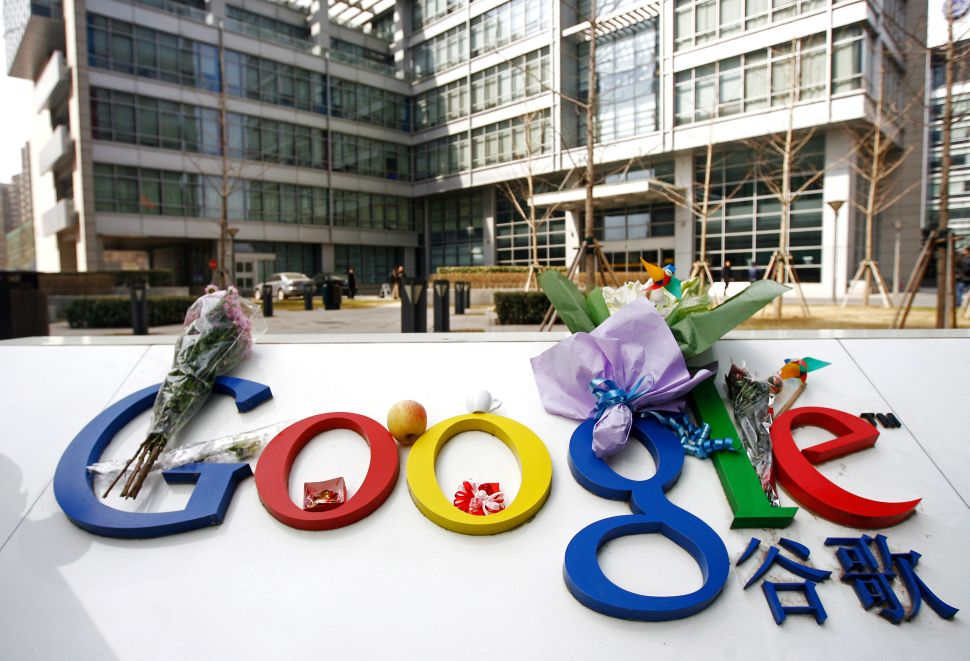 People left bouquets of flowers on the Google logo outside the company's China office in Beijing to mourn its closing in 2010.