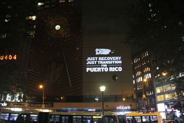 The Illuminator projects 'Just Recovery, Just Transition for Puerto Rico' in Union Square in New York City.
