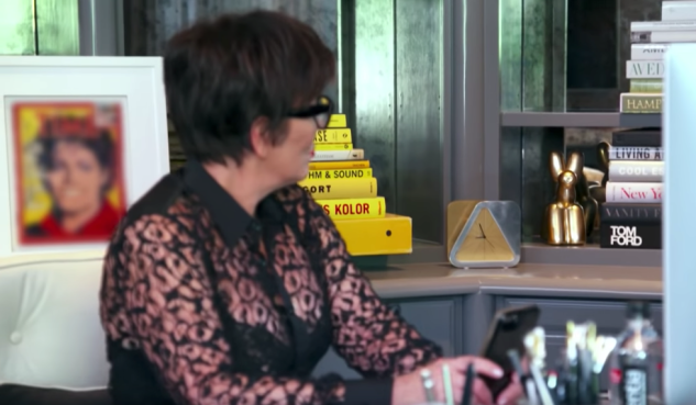 Kris Jenner casts a glance at the offending sculpture, a Jeff Koons (in case you didn't know).