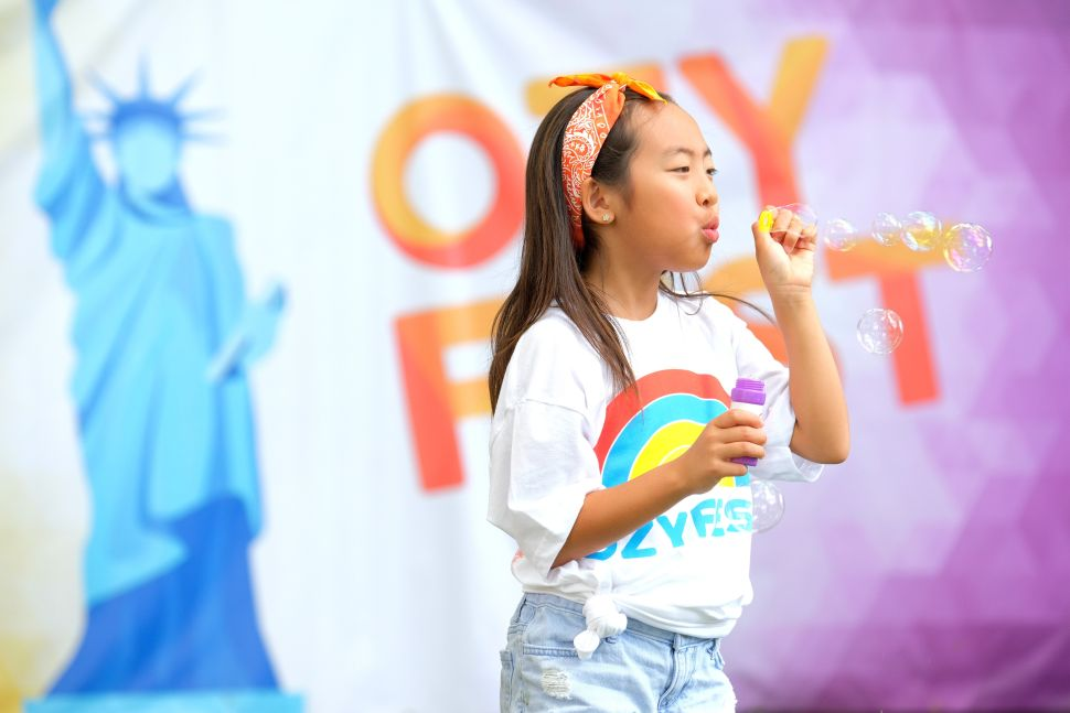Ozy Fest in Central Park attracts tourists blowing bubbles, but Ozy prefers to blow raspberries at other media outlets.
