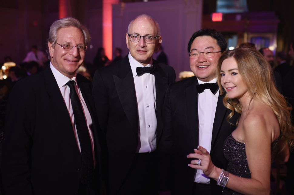 Jho Low (2nd R) and guests attend Angel Ball 2014 hosted by Gabrielle's Angel Foundation at Cipriani Wall Street on October 20, 2014 in New York City.