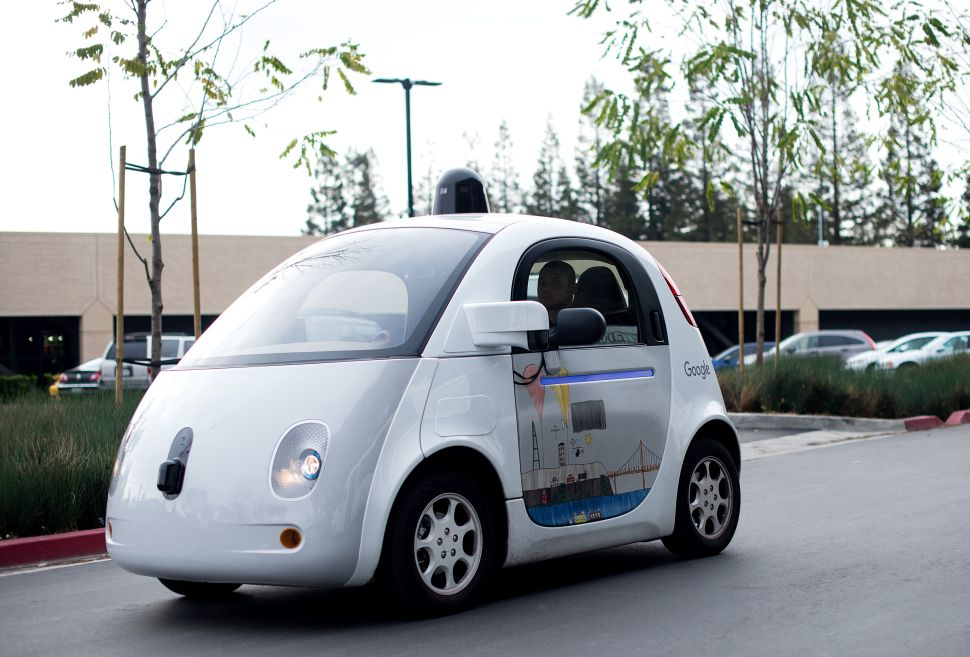 A self-driving car traverses a parking lot at Google's headquarters in Mountain View, California.