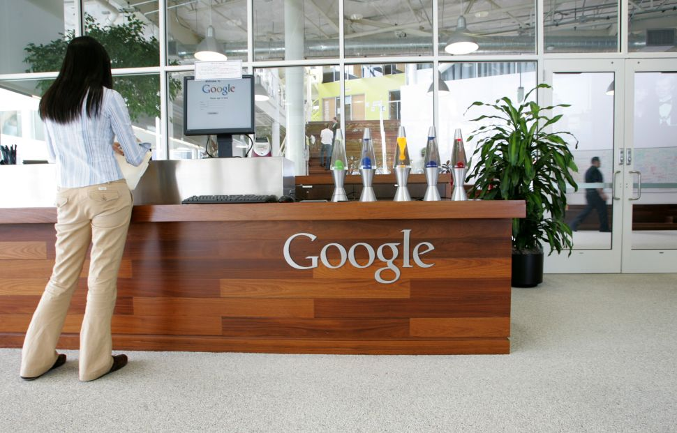 A Google employee stands in a lobby at the Googleplex in Mountain View, California.