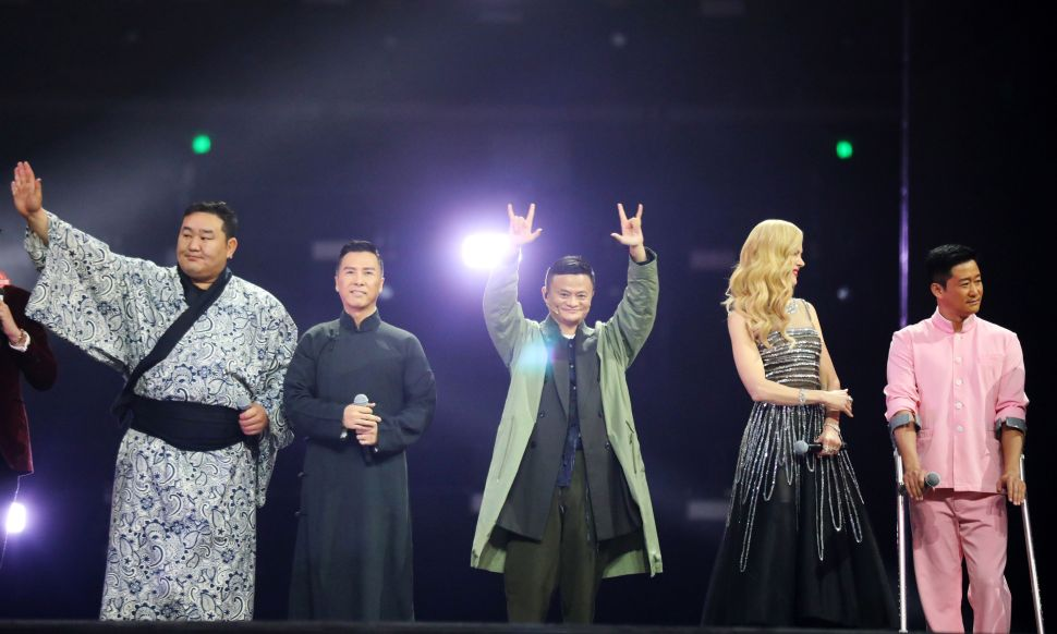 Jack Ma (C) greets spectators with Mongolia's former sumo wrestler Asashōryū Akinori (L), Chinese actors Donnie Yen (2L) and Wu Jing (R) and Australian actress Nicole Kidman (2R) as they promote Gong Shou Dao in November 2017.