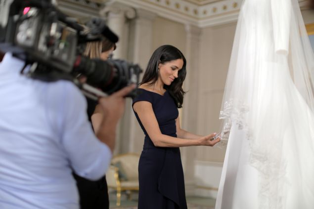 Meghan Markle with her wedding gown.