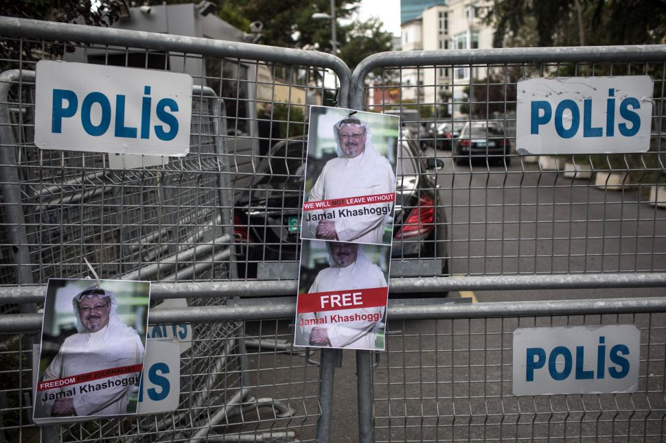 Posters of missing Saudi journalist Jamal Khashoggi stuck to a police barricade outside Saudi Arabia's consulate in Istanbul, Turkey.