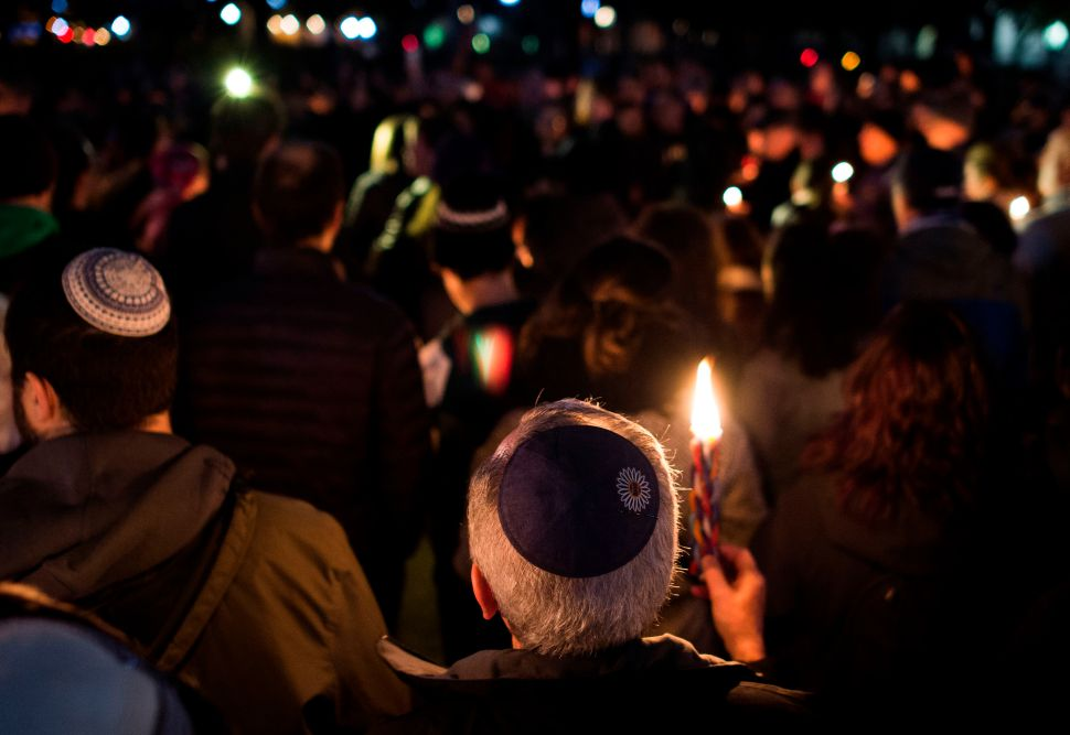 Members and supporters of the Jewish community come together for a candlelight vigil, in remembrance of those who died on Saturday during a shooting at the Tree of Life Synagogue in Pittsburgh.