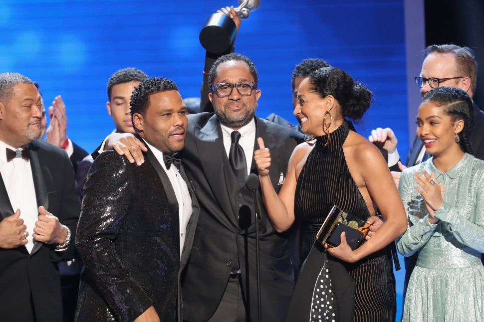 Co-recipients Laurence Fishburne, Anthony Anderson, Kenya Barris, Tracee Ellis Ross and Yara Shahidi accept the award for Outstanding Comedy Series 'Black-ish' on-stage at the 48th NAACP Image Awards.