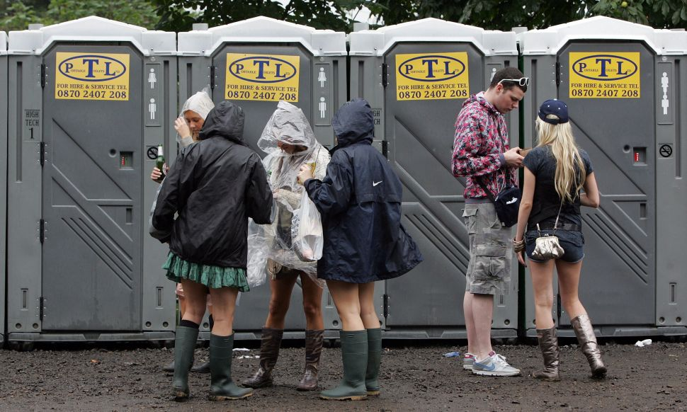 People wait for toilets during the second day of the 2007 V Festival.