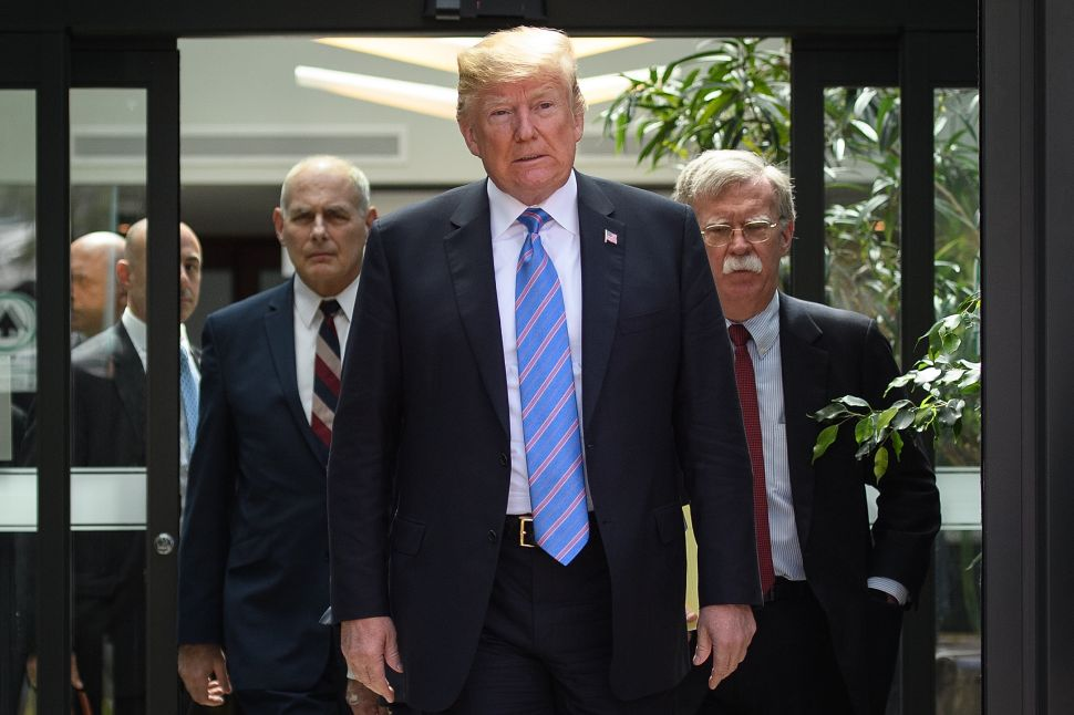President Donald Trump with Chief of Staff John Kelly and National Security Advisor John Bolton.