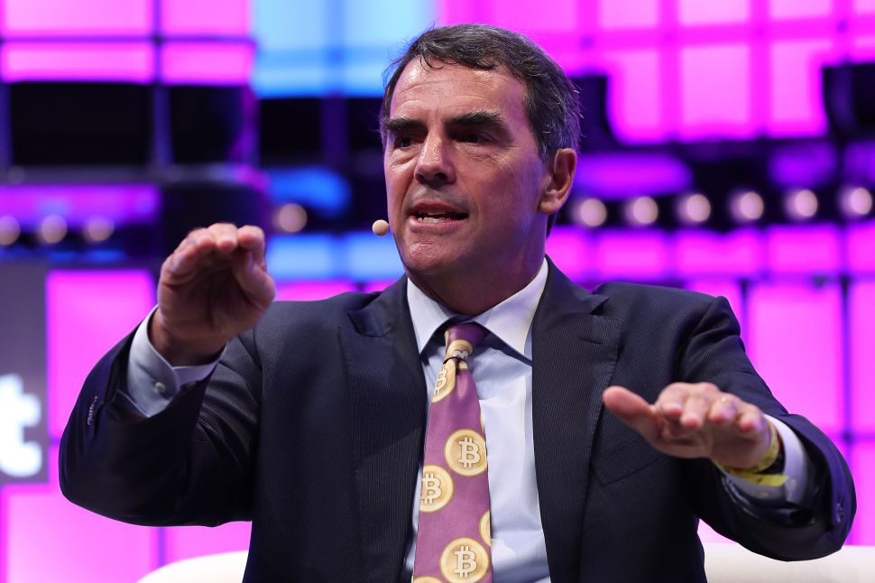 "Tim Draper at the Web Summit 2018 in Lisbon, Portugal on November 6, 2018 wearing a ""Bitcoin tie."""