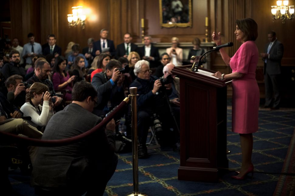 WASHINGTON, DC - NOVEMBER 7: Democratic Leader Nancy Pelosi speaks with reporters in the Rayburn Room at the Capitol in Washington.