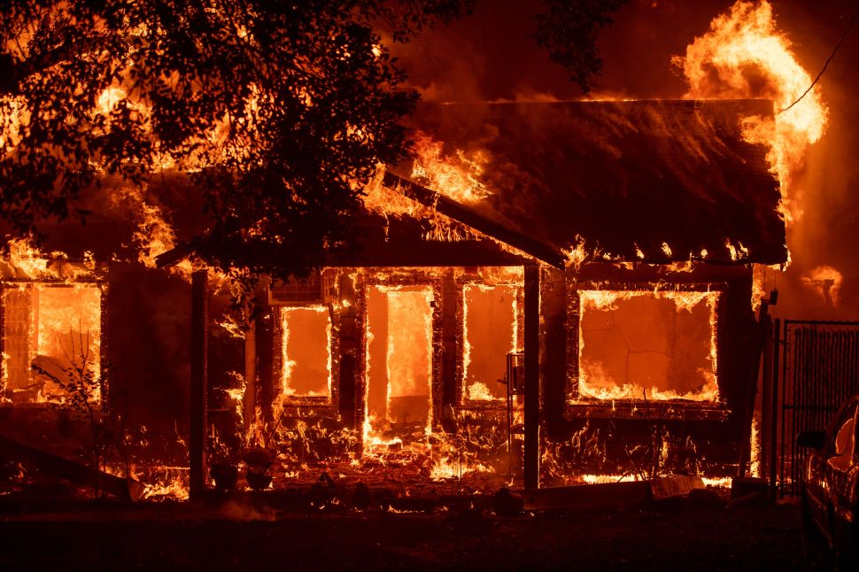 A home burns as the Camp Fire tears through Paradise, California on November 8, 2018.