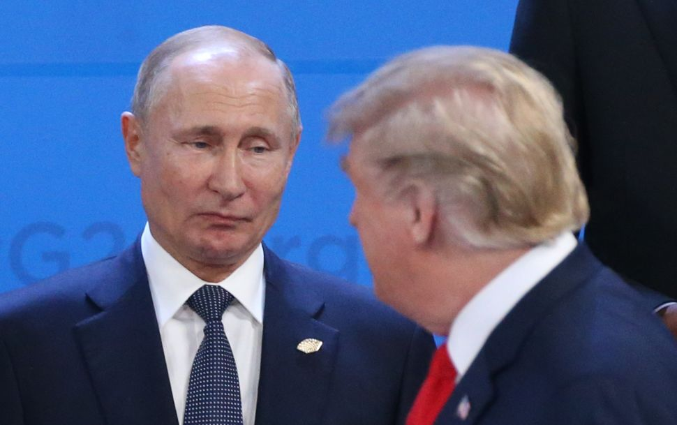 Putin and Trump at the G20 Summit welcoming ceremony on November 30, 2018 in Buenos Aires, Argentina.