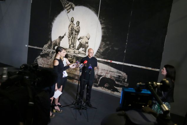 Steve Lazarides doing press before the exhibition's opening in Melbourne in 2016.