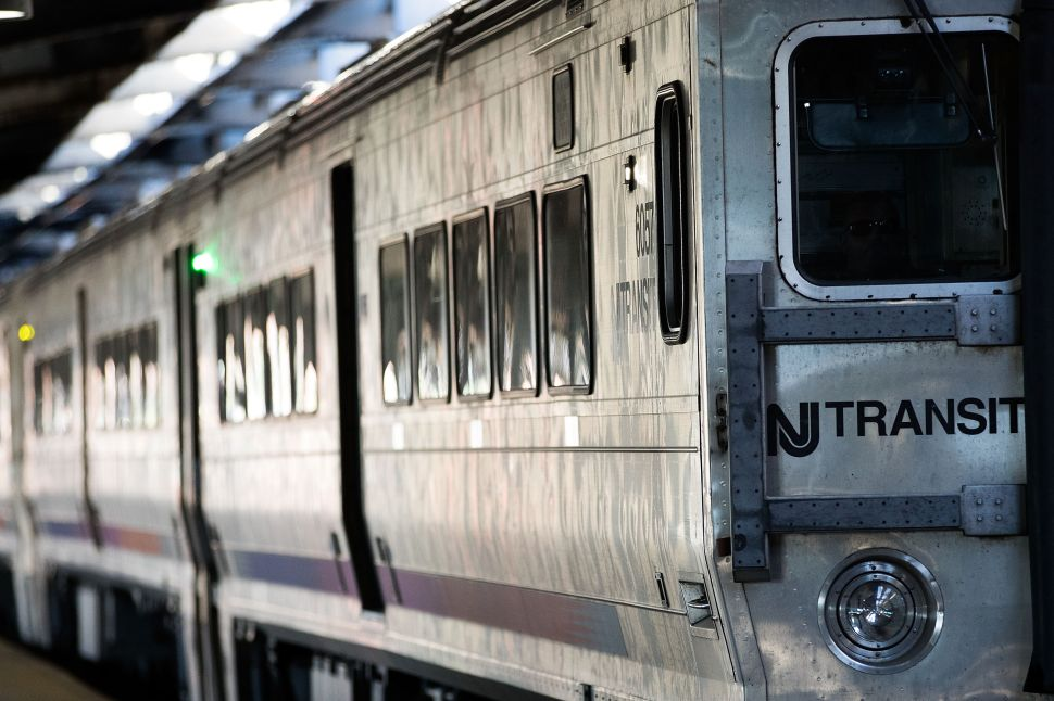 A New Jersey Transit train arrives at Hoboken Terminal during a morning rush hour.