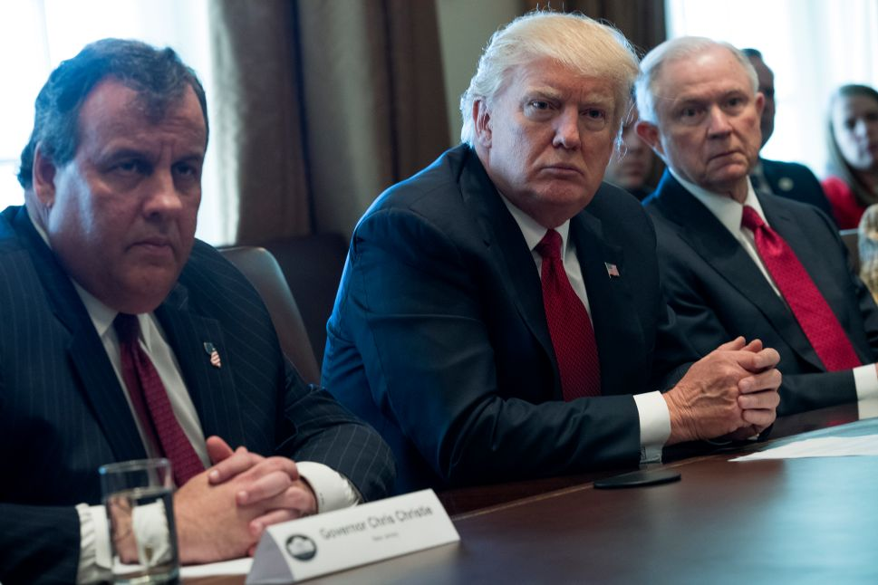 U.S. President Donald Trump (C), New Jersey Gov. Chris Christie (L) and Attorney General Jeff Sessions (R) attend a panel discussion on an opioid and drug abuse in the Roosevelt Room of the White House March 29, 2017 in Washington, DC.