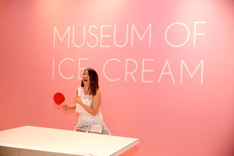 Visitors play ping pong during the Museum of Ice Cream's opening party on September 15, 2017 in San Francisco, California.
