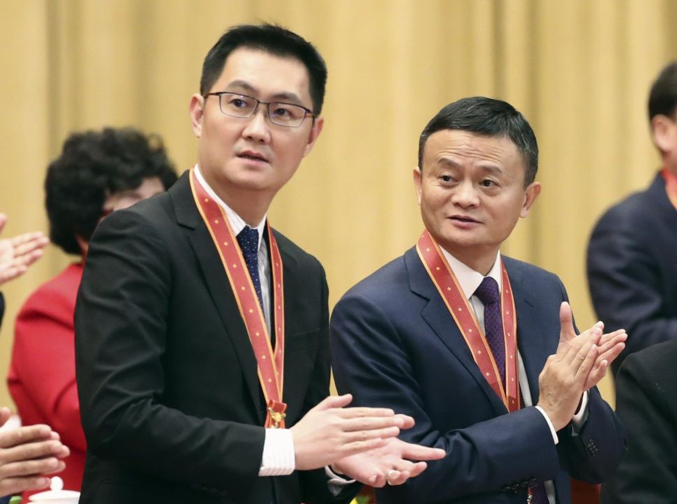 "Alibaba founder Jack Ma (R) and Tencent founder Pony Ma at the 40th Anniversary ceremony of ""Reform and Opening Up"" on December 18, 2018 in Beijing."
