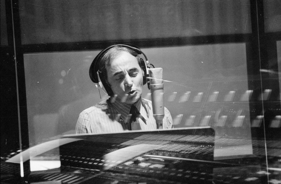 French singer and songwriter Charles Aznavour performing in a recording studio on September 10, 1974.